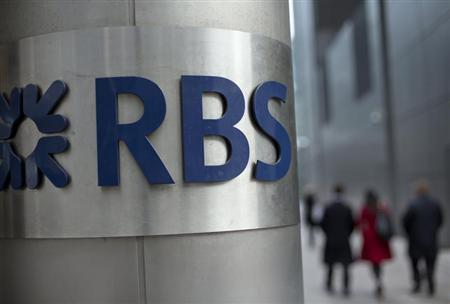 People walk past a Royal Bank of Scotland office in London February 6, 2013. REUTERS/Neil Hall