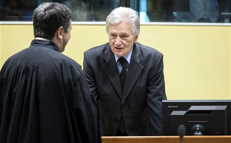 Momcilo Perisic (R), the former chief of staff of the Yugoslav army, attends a hearing in the courtroom of the Yugoslav War Crimes Tribunal (ICTY) in The Hague February 28, 2013. REUTERS/Koen Van Weel/ANP/Pool