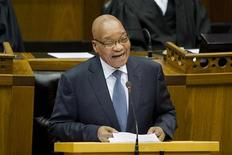 South African President Jacob Zuma laughs as he delivers his State of the Nation Address after the formal opening of Parliament in Cape Town February 14, 2013. REUTERS/Rodger Bosch/Pool