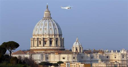 A helicopter carrying Pope Benedict XVI takes off from inside the Vatican on its way to the papal summer residence at Castelgandolfo, February 28, 2013. REUTERS/Stefano Rellandini