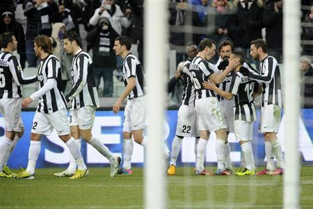 Juventus' Sebastian Giovinco (2nd R) celebrates with teammates after scoring against Siena during their Italian Serie A soccer match at the Juventus stadium in Turin February 24, 2013. REUTERS/ Giorgio Perottino