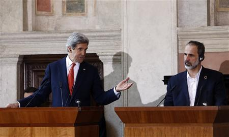 U.S. Secretary of State John Kerry (L) gestures next to Syrian National Coalition head Mouaz al-Khatib during a news conference at Villa Madama in Rome February 28, 2013. REUTERS/Remo Casilli
