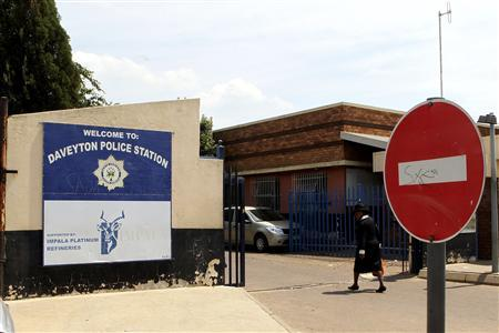 A women enters the Daveyton Police station, east of Johannesburg February 28, 2013. REUTERS/Stringer