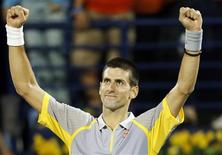 Novak Djokovic of Serbia celebrates after his men's singles quarter-final match against Andreas Seppi of Italy during the ATP Dubai Tennis Championships, February 28, 2013. REUTERS/Mohammed Salem