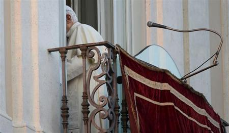 Pope Benedict XVI leaves as he appears for the last time at the balcony of his summer residence in Castelgandolfo, south of Rome, February 28, 2013. REUTERS/Max Rossi