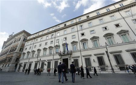Police patrol in front of Chigi palace in Rome February 28, 2013. REUTERS/Yara Nardi