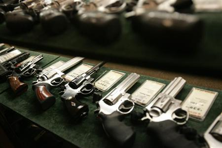 Guns are seen inside a display case at the Cabela's store in Fort Worth, Texas, June 26, 2008. REUTERS/Jessica Rinaldi