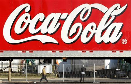 A man walks past a Coca-Cola truck at a distribution center in Alexandria, Virginia October 16, 2012. REUTERS/Kevin Lamarque/Files