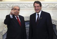 Cyprus's new President Nicos Anastasiades (R) stands next to his predecessor Demetris Christofias at the presidential palace in the capital Nicosia February 28, 2013. REUTERS/Andreas Manolis