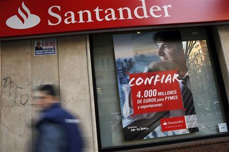 A man walks past a Santander bank branch in Madrid January 31, 2013.REUTERS/Susana Vera