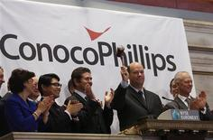 ConocoPhillips Chairman and Chief Executive Officer Ryan M. Lance (2nd R) rings the closing bell at the New York Stock Exchange (NYSE), February 27, 2013. REUTERS/Brendan McDermid