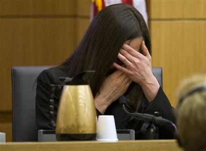 Jodi Arias breaks down after being asked by prosecutor Juan Martinez if she was crying when she stabbed Travis Alexander and when she slit his throat, in Maricopa County Superior Court in Phoenix, Arizona, February 28, 2013. REUTERS/Tom Tingle/The Arizona Republic/Pool