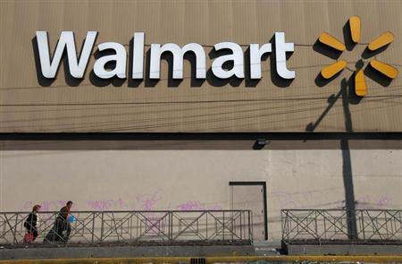 Two people walk outside a Wal-Mart store in Mexico City January 11, 2013. REUTERS/Edgard Garrido
