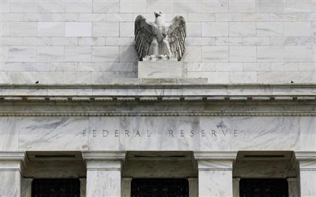 A view shows an eagle sculpture on Federal Reserve building, on the day it will release minutes of Federal Open Market Committee from August 1, 2012, in Washington August 22, 2012. REUTERS/Larry Downing