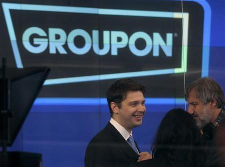 Groupon Chief Executive Andrew Mason (L) prepares for the opening bell ceremony celebrating his company's IPO at the Nasdaq Market in New York in this file November 4, 2011 photo. REUTERS/Brendan McDermid