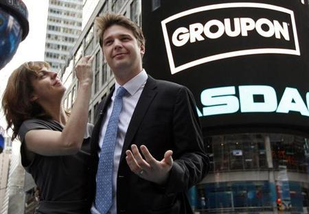Groupon CEO Andrew Mason poses with his newly married wife, pop musician Jenny Gillespie, outside the Nasdaq Market following his company's IPO in New York, November 4, 2011. REUTERS/Brendan McDermid/Files