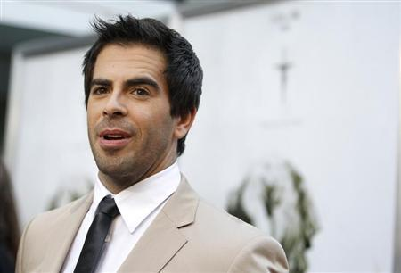 Producer Eli Roth poses at the premiere of ''The Last Exorcism'' at the Arclight theatre in Hollywood, California in this file photo taken August 24, 2010. REUTERS/Mario Anzuoni