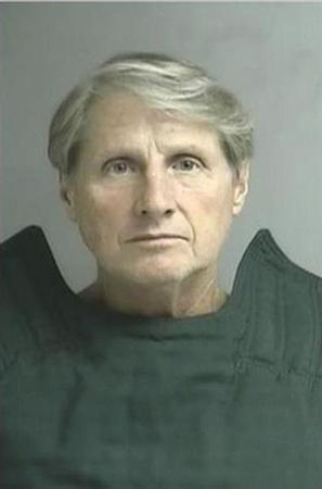 Peregrine Financial Group's former Chief Executive Russell Wasendorf Sr. wears an anti-suicide tunic following his arrest on charges of lying to federal regulators in Cedar Falls, Iowa July 2012. REUTERS/Linn County Jail/Handout