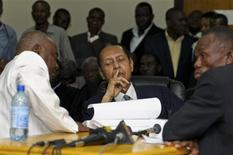 "Former Haitian Dictator Jean Claude ""Baby-Doc"" Duvalier (C) listens as charges against him are announced during an appeals court hearing in Port-au-Prince February 28, 2013. REUTERS/Swoan Parker"