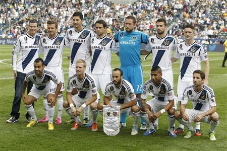 The Los Angeles Galaxy team poses before playing against the Houston Dynamo before the MLS Cup championship soccer game in Carson, California, in this file photo taken December 1, 2012. REUTERS/Danny Moloshok