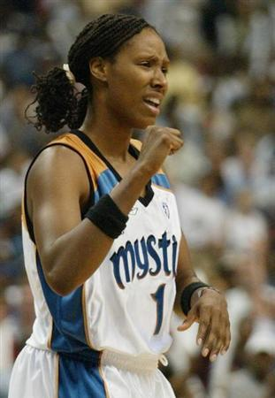 Washington Mystics' Chamique Holdsclaw celebrates her team taking the lead from the New York Liberty during the second half of the WNBA Eastern Conference finals at MCI Center in Washington in this file photo taken August 22, 2002. REUTERS/Molly Riley