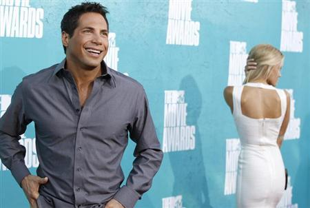 ''Girls Gone Wild'' founder Joe Francis (L) arrives at the 2012 MTV Movie Awards in Los Angeles June 3, 2012. REUTERS/Danny Moloshok/Files