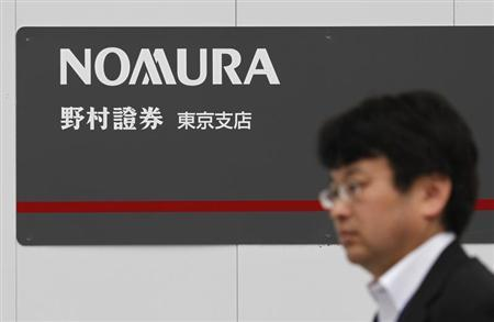 A man walks past a sign of Nomura Securities in Tokyo October 27, 2012. REUTERS/Toru Hanai