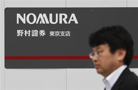 A man walks past a sign of Nomura Securities in Tokyo October 27, 2012. REUTERS/Toru Hanai