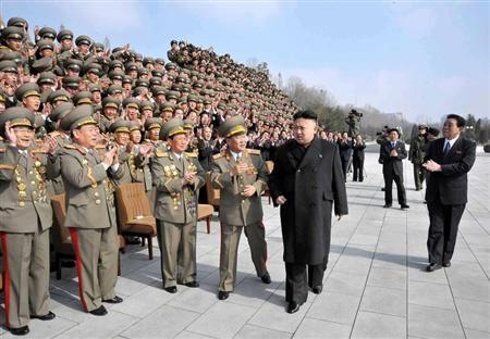 North Korean leader Kim Jong-Un (front R) leaves after attending a photo session with participants of a meeting of officials guiding party lectures for the whole army, in this undated recent picture released by the North's official KCNA news agency in Pyongyang on February 23, 2013. REUTERS/KCNA