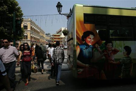 People cross a street at Largo do Senado, a popular square, in Macau October 11, 2012. REUTERS/Bobby Yip