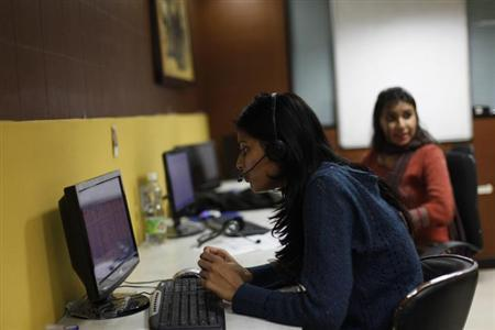 Sheetal, 23, who works at a night call centre, poses for a photograph in her office in New Delhi January 12, 2013. REUTERS/Mansi Thapliyal