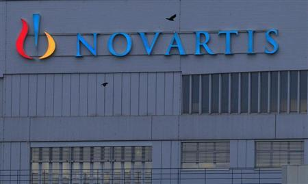 A logo is pictured on a building of Swiss drug maker Novartis before its annual general meeting in Pratteln near Basel February 22, 2013. REUTERS/Arnd Wiegmann