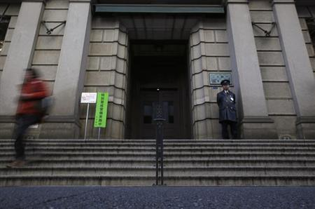 A security officer stands guard at an entrance of Bank of Japan headquarters in Tokyo February 25, 2013. REUTERS/Yuya Shino