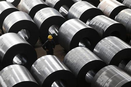 An employee works at a steel factory that exports to Europe and America in Jiaxing, Zhejiang province, February 28, 2013. REUTERS/William Hong