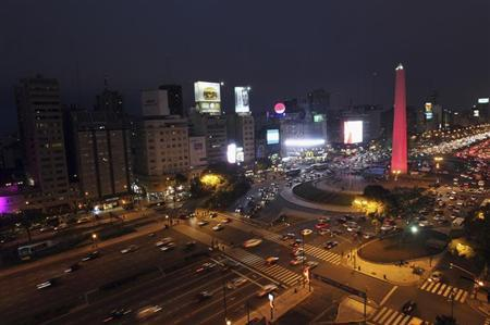 The Obelisk is lighted up in red, as part of a campaign to raise awareness in cardiovascular diseases driven by the City's government, in the city of Buenos Aires September 5, 2012. REUTERS/Enrique Marcarian
