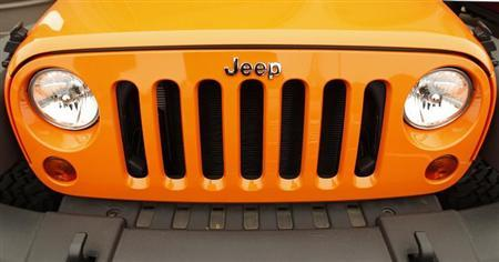 The grill of a Jeep is pictured at a Chrysler/Jeep dealership in Vienna, Virginia April 26, 2012. REUTERS/Kevin Lamarque