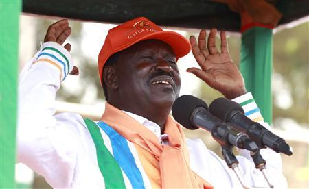 Kenya's Prime Minister Raila Odinga (R), presidential candidate of the Coalition for Reforms and Democracy (CORD), addresses his supporters during a campaign rally in Thika town, 40 km (25 miles) from the capital Nairobi, February 26, 2013. Kenya will hold its presidential and parliamentary elections on March 4. REUTERS/Thomas Mukoya