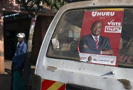 A mini-van with a campaign poster of Kenya's Deputy Prime Minister and presidential candidate Uhuru Kenyatta drives along the Kangemi slum in Kenya's capital Nairobi February 28, 2013. Kenya will hold its presidential and parliamentary elections on March 4. REUTERS/Siegfried Modola