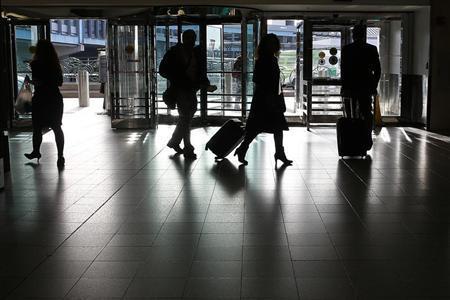 People walk though LaGuardia airport in New York, November 19, 2012. REUTERS/Carlo Allegri
