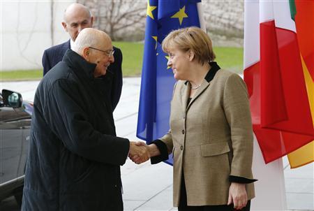 German Chancellor Angela Merkel welcomes Italy's President Giorgio Napolitano for talks in Berlin February 28, 2013. REUTERS/Tobias Schwarz