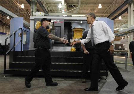 U.S. President Barack Obama meets workers as he tours Linamar Corporation, a manufacturer of parts for the truck industry in Arden, North Carolina, February 13, 2013. REUTERS/Jason Reed