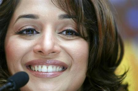 Actress Madhuri Dixit smiles during a news conference to promote her movie ''Aaja Nachle,'' or ''Come Let's Dance'' in New Delhi, November 27, 2007. REUTERS/Vijay Mathur/Files