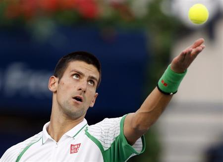 Novak Djokovic of Serbia serves to Juan Martin Del Potro of Argentina during their men's singles semi-final match at the ATP Dubai Tennis Championships, March 1, 2013. REUTERS/Ahmed Jadallah