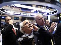 Wall Street a effacé ses pertes vendredi à la suite de la publication d'un indice ISM manufacturier à son plus haut niveau en un an et demi pour le mois de février. Le Dow Jones gagnait 0,02% près d'une heure après l'annonce de l'ISM, le Standard & Poor's 500 prenait 0,02% tandis que le Nasdaq Composite cédait encore 0,13%. /Photo prise le 1er mars 2013/REUTERS/Brendan McDermid