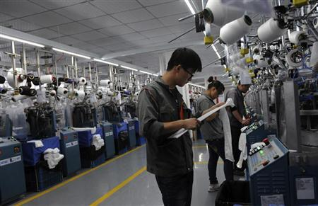 Chinese college students majoring in textile work at a garment factory in Jiaxing, Zhejiang province, October 19, 2012. REUTERS/Stringer