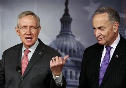 Senate Majority Leader Harry Reid (D-NV) (L) speaks next to Senator Chuck Schumer (D-NY) at a news conference on Capitol Hill in Washington February 28, 2013. REUTERS/Larry Downing