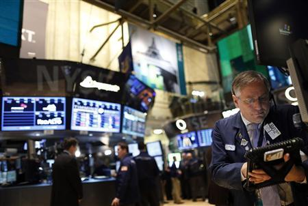 Trader Warren Meyers works on the floor of the New York Stock Exchange, March 1, 2013. REUTERS/Brendan McDermid (UNITED STATES - Tags: BUSINESS)