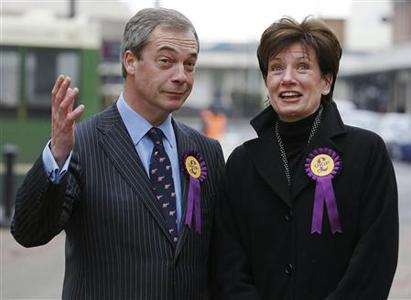 UK Independence Party (UKIP) leader Nigel Farage, and Eastleigh UKIP candidate Diane James, pose for members of the media in Eastleigh, southern England March 1, 2013. REUTERS/Luke MacGregor