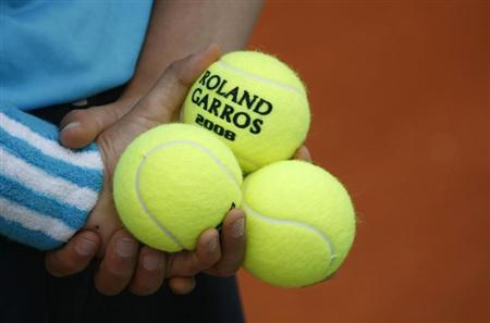 A ball boy holds tennis balls during an exhibition match ahead of the French Open tennis tournament at the Roland Garros stadium in Paris in this file photo taken May 24, 2008. REUTERS/Francois Lenoir