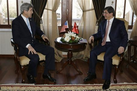 U.S. Secretary of State John Kerry (L) speaks with Turkish Foreign Minister Ahmet Davutoglu during their meeting at Ankara Palas in Ankara March 1, 2013. REUTERS/Jacquelyn Martin/Pool (TURKEY - Tags: POLITICS)